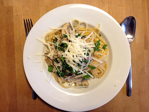 Tagliatelle with mushroom sauce and fresh parsley