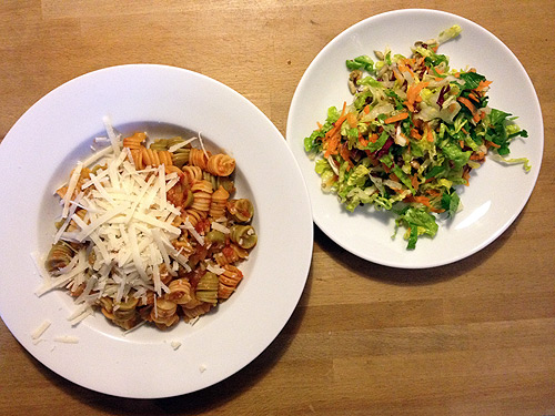 Pasta tricolore with olive-tomato-sauce and mixed salad